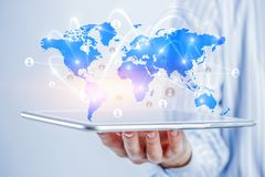 Global communication and networking. Close of businessman holding tablet pc and media world map on screen. Mixed media Royalty Free Stock Photo