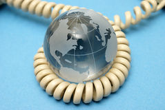 Global Communications. A globe and phone cord represent global communications Stock Images