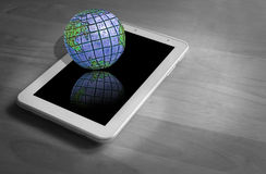 Global communications internet. Conceptual photo of world resting on tablet device depicting global communications,connections etc Stock Image
