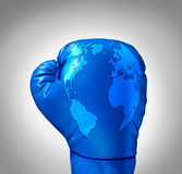 Global Competition. And competing globally as a business concept with a blue leather boxing glove with a map of the world incorporated in the texture as a Royalty Free Stock Image