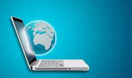 Global through computer laptop  Royalty Free Stock Photo