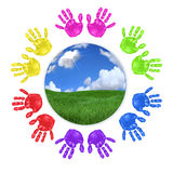 Global Concept of Children's Handprints Around the Stock Photo