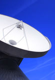 Global Contact. Huge satellite dish with blue sky Royalty Free Stock Photos