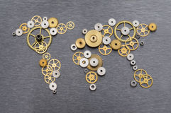 Global cooperation. World map formed by gears stock images