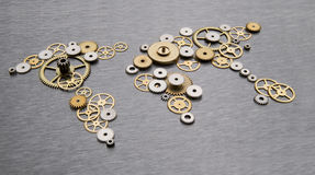 Global cooperation. World map formed by gears stock photography