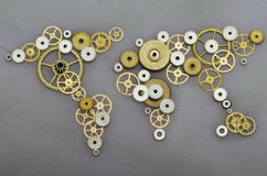 Global cooperation. World map formed by gears royalty free stock photo