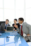 Global corporate meeting. Multi ethnic group of corporate people attending a meeting Royalty Free Stock Image
