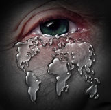 Global Crisis. And globe stress with a human tear drop flowing from a sad depressed eye shaped as a world map as a concept for environmental damage to the Royalty Free Stock Image