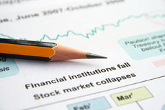 GLobal crissis. Stock chart  pencil   on global crisis report Royalty Free Stock Images