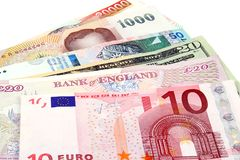 Global Currency. A collection of foreign currencies including Euros, American Dollars, British Pounds, Thai Baht, Malaysian Ringit Stock Photos