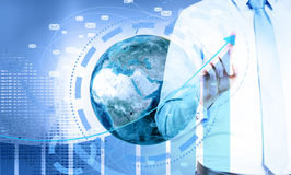 Global e-mail marketing. Concept. Businessman pointing at business chart top on digital background with globe and network. Elements of this image furnished by Royalty Free Stock Photography