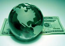 Global Economy 1. Representation of the earth resting on money Royalty Free Stock Images