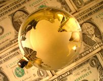 Global Economy. A globe with money background royalty free stock photography