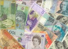 Global economy. International currencies - european, middle east, american. Banknotes background Royalty Free Stock Photos