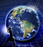 Global economy. A silhouette of a man carrying a attache or brief case on a grid with the globe in the background. Concept for global business or finances stock images