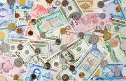 Global Economy. Money from Different Countries depicting a Global/World Economy. Money from Belize, Bermuda, Grand Cayman, Jamaica, Mexico, Slovakia and the Royalty Free Stock Photo