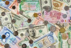 Global Economy. Money from Different Countries depicting a Global/World Economy. Money from Belize, Bermuda, Grand Cayman, Jamaica, Mexico, Slovakia and the Stock Photography