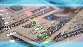 Global economy, finance, business, invest wallpaper. Finance, business, economy, invest  wallpaper. Stock market data at background of 100 dollar bills Stock Images