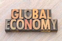 Global economy word abstract in wood type. Global economy word abstract in vintage letterpress wood type Stock Images