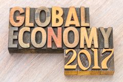 Global economy 2017 - word abstract in wood type Stock Photography