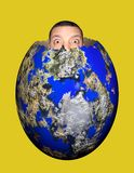 Global egg. Man looking from global egg Stock Photography