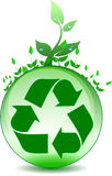 Global environmental recycling. Leaves atop a glass globe representing nature, recycling.  With recycling symbol Stock Photos