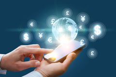 The global financial market in the phone. Royalty Free Stock Photos