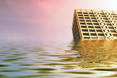 Global flooding. Simulated flood waters engulf tower blocks in city centre Stock Images