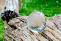 Global glass ball on wooden Royalty Free Stock Photos