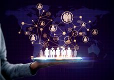 Global and HR concept. Hand holding tablet with glowing social network map on dark background. Global and HR concept royalty free stock photos