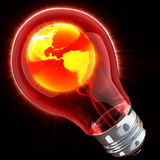 Global idea. Shining globe inside light bulb Stock Photography
