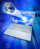 Global Information Computer Technology. A world globe connected to a laptop computer with circuits and stars background Royalty Free Stock Photos