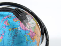 Global INTERNET communication. An INTERNET cable surrounding a earth globe suggesting global modern communication Stock Image
