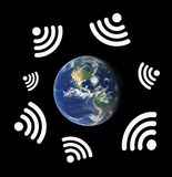 Global internet. Planet Earth is surround by symbols of Wi-fi - global connection to internet site and web. Digital innovation - general access to online and Stock Photography