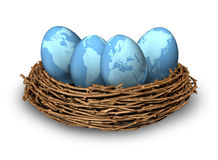 Global Investments. And international finance business symbol with four blue eggs with the maps of the world in a nest as a concept of savings and money Stock Photo