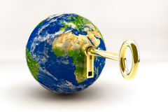 Global Key. A world globe with a golden key and lock Stock Images