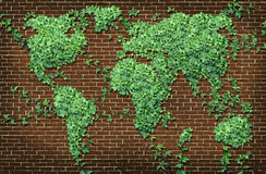Global Leaf Map. In the shape of growing green vine plant on a red brick wall as a world concept of network connections with the Americas and Europe and Africa Royalty Free Stock Photo