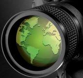 Global lense. Image of world map on a camera lense Stock Image