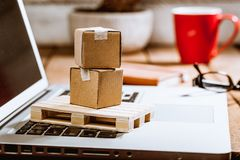 Carton boxes on computer as online shopping logistics concept. Global logistics concept with online trading and shopping in the internet, packages to be stock image