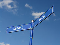 global lokal signpost Fotografering för Bildbyråer