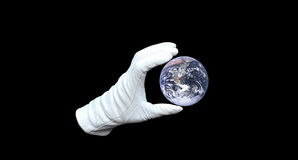 Global manipulator. Hand in white glove holding world globe royalty free stock photography