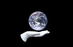 Global manipulator. Hand in white glove holding world globe Royalty Free Stock Image