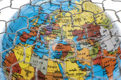 The global map behind a wire fence. Global map behind a wire fence royalty free stock photography