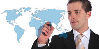 Global market expansion. A handsome businessman presenting concepts of global market expansion. All on white background Royalty Free Stock Photo