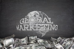 Global marketing concept on blackboard Royalty Free Stock Photo