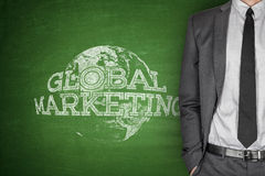 Global marketing concept on blackboard Royalty Free Stock Photos