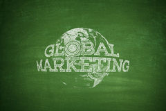 Global marketing concept on blackboard Stock Photo