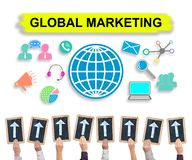 Global marketing concept on a whiteboard. Hands holding writing slates with arrows pointing on global marketing concept royalty free stock image