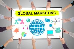 Global marketing concept on a whiteboard. Hands pointing to global marketing concept stock photos