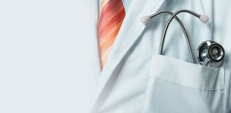Global medicine Ana Health Care Concept. Unrecognizable doctor in white coat with stethoscope, closeup royalty free stock images